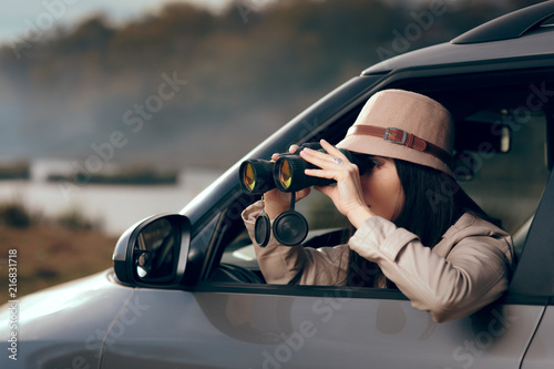 Fotografie, Tablou  Female Detective Spying with Binocular from a Car