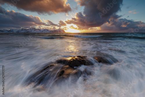 Foto op Plexiglas Zee zonsondergang Sunset on the rough sea, Vikten, Flakstad municipality, Lofoten Islands, Norway