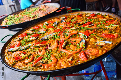 Spanish paella prepared in the street restaurant