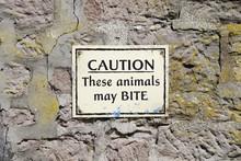 Animals May Bite Warning Sign At Zoo Safari Park
