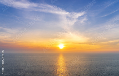 scenic of sunset on seascape skyline background