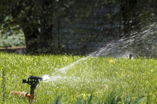 Water Sprinkler Irrigation Of Lawns On A Hot Summer Day