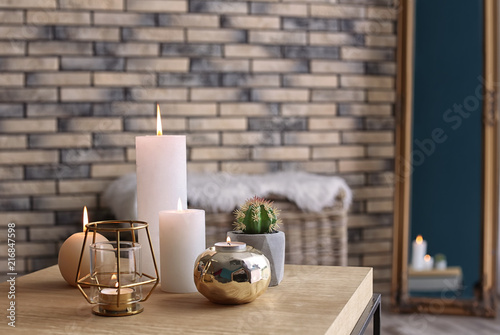 Fotografie, Obraz  Burning candles on table indoors. Interior decor element
