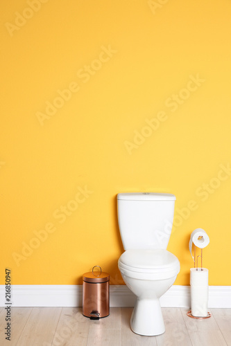 Fotografia  New ceramic toilet bowl in modern bathroom with space for text