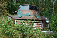Old Abandoned Truck In The Woods