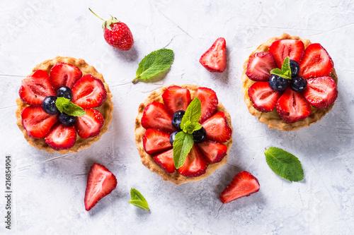 Fototapeta Strawberry tart on white table. Top view.
