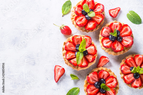 Photo sur Toile Dessert Strawberry tart on white. Summer dessert with berries