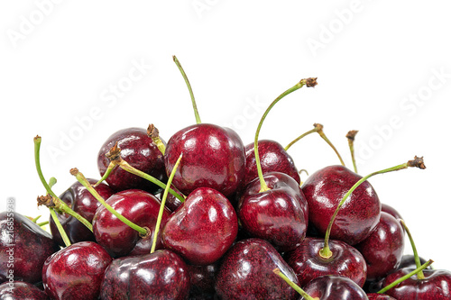 Fotografía  close up of ripe red cherries on white background