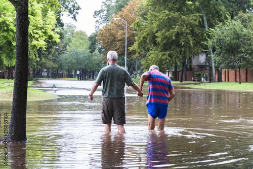 Fototapeta Residents navigates hight flood waters