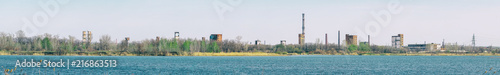 Foto op Aluminium Oude verlaten gebouwen Panorama Old Abandoned chemical factory with chimneys on the banks of the river