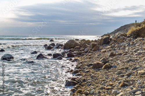 Tuinposter Kust Picturesque stony coast of the big natural lake