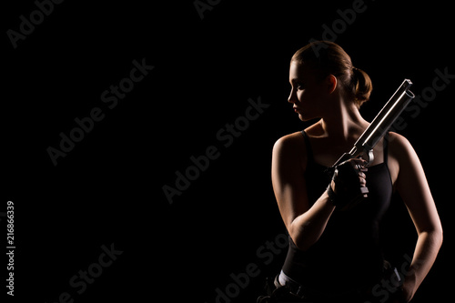 Photo  Military woman with a sport gun over black background