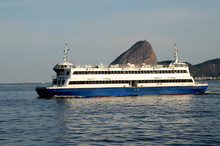 Rio Niteroi Crossing Ferry In Front Of Sugarloaf