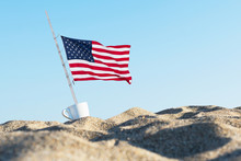 American Flag In The Sand Agai...