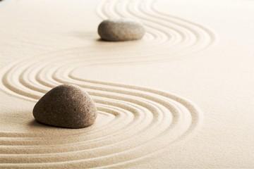Fototapeta na wymiar Zen stones in the sand