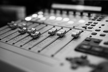 Sound Recording Studio Mixing Desk. Music Mixer Control Panel. Closeup. Selective Focus. Black And White Image