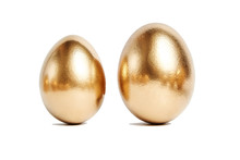 Two Golden Eggs Isolated On White Background. Conceptual Image