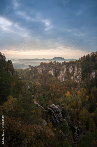 Deurstickers Australië Great morning light with fog and clouds in the german Saxon Switzerland National Park close to Dresden. Hiking and climbing in wonderful mountain ranges of the Elbe Sandstone Mountains.