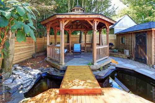 Tablou Canvas Fabulous gazebo with a pond in the back yard.