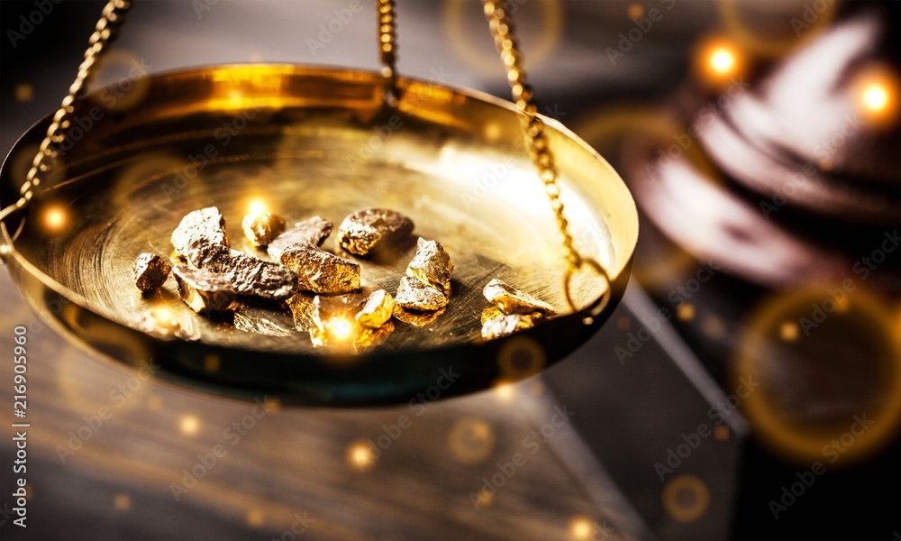 Fototapeta Small gold nuggets in an antique measuring