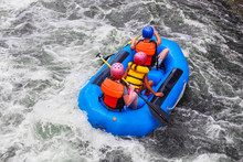 Three People In A Raft In Whit...