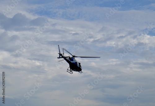 Tuinposter Helicopter Policía helicóptero