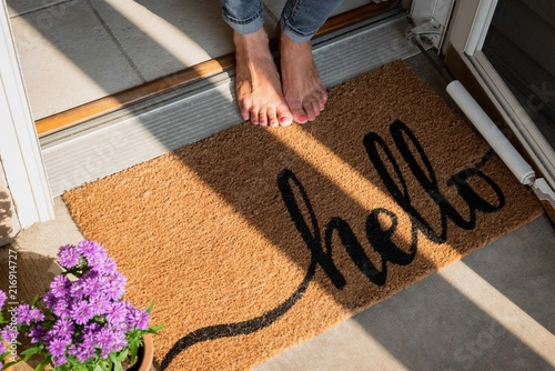 Valokuvatapetti welcome mat in front of new home