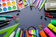 School supplies on a black background, back to school, concept education