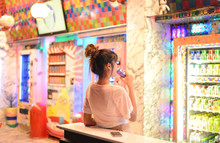 Roiet, Thailand - 26 Dec, 2016 :  An Unidentifed Woman Posting In Front Of Colorful Japanese Vending Machines