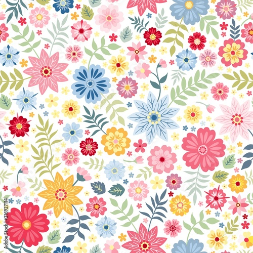 Seamless ditsy floral pattern with cute little flowers on white background. Vector illustration. Print for fabric, paper, wallpaper, wrapping design.
