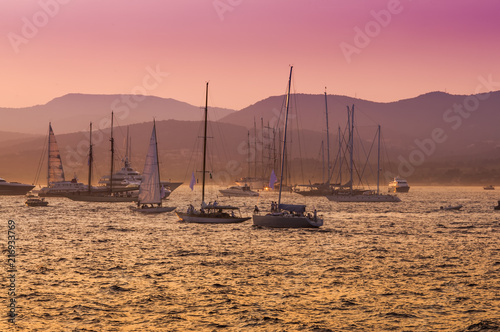 Valokuva sail boats and yacht at sea sunset. Saint Tropez, France