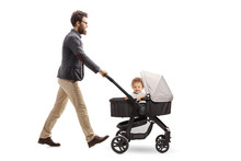 Father Pushing A Baby Stroller