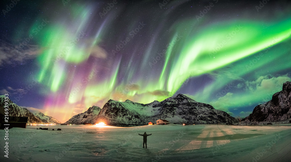 Fototapety, obrazy: Aurora borealis (Northern lights) over mountain with one person