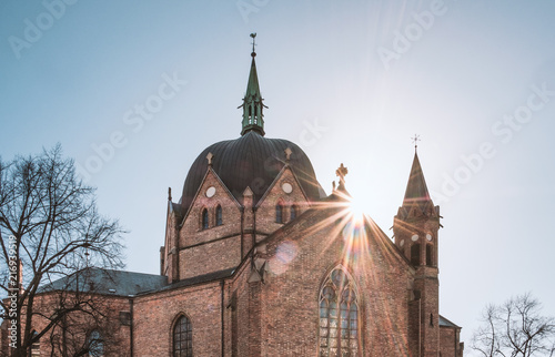 Photo  Sunshine on Trinity historic red brick church in Oslo