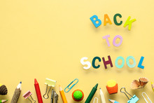 Back To School Background Concept. Back To School Wood Text Arrange On Yellow Background With School Supplies, Stationery Accessories. Flat Lay, Top View