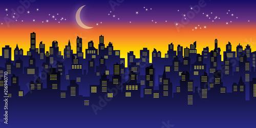 三日月と星と夕焼けの都市景観
