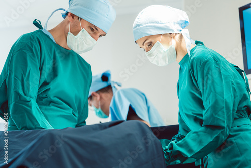 Stampa su Tela Doctors and surgeons operating patient in hospital with full concentration