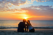 Couple watching the sunset on the beach