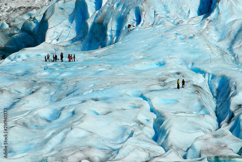 Glaciers People hiking at the Jostedalsbreen glacier, the biggest glacier in continental Europe, located in Sogn og Fjordane county, Norway.