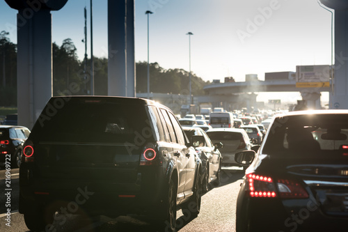 Obraz Traffic jam on a hot summer evening. Highway and road junction. Sunset and cars - fototapety do salonu