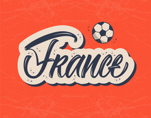 France Brush Lettering Sign With Ball Icon On Red Textured Background