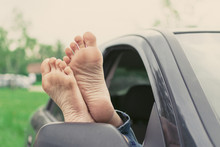 Summer Road Trip Car Vacation Concept. Woman Legs Out The Windows In Car. Conceptual Freedom, Travel And Holidays Image.