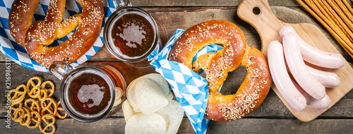 Canvas Print Oktoberfest concept - traditional food and beer on rustic background
