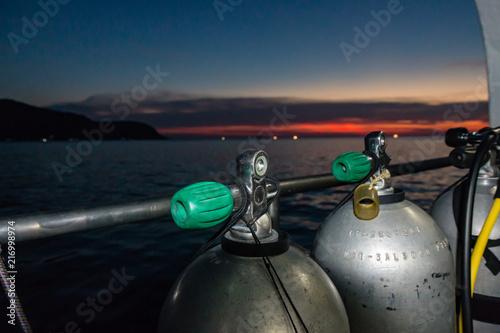 Fotografie, Tablou SCUBA tanks on a dive boat prior to a night dive