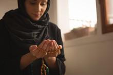 Muslim Woman With Prayer Beads...