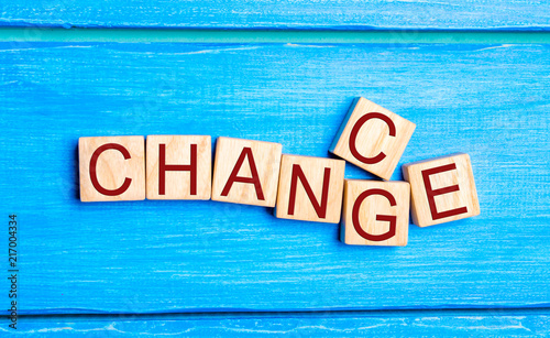 """Fotografie, Obraz  Wooden cube with word """"change"""" to """"chance"""" on wood table"""