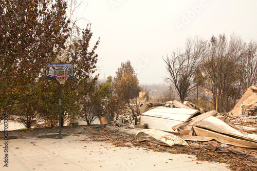 Fotografie, Obraz  home burned to the ground, garage door buckled but basketball hoop untouched after the wild fire fire storm in Redding, CA