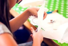 Children Hands Making Artworks With Wood And Paint Crafts. Workplace And Handcraft