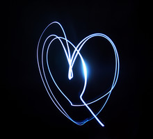 Neon Blue Heart On A Black Background, Light Picture, Abstract Art.
