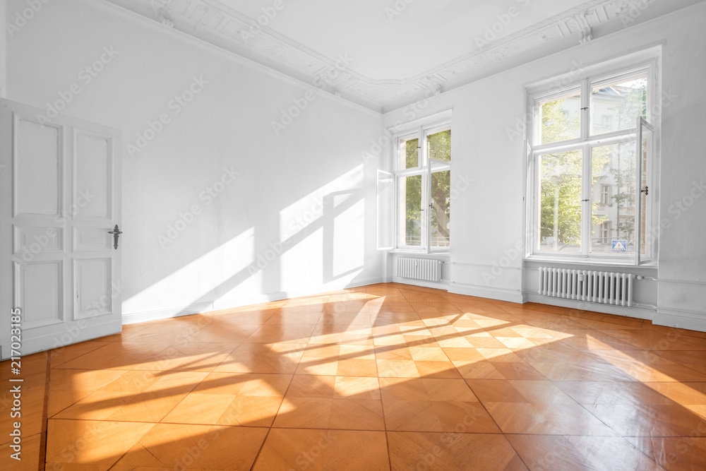 Fototapeta empty room in beautiful flat with wooden  floor - real estate interior